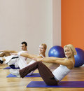 People doing fitness exercise Stock Images