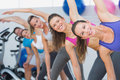 People doing power fitness exercise in fitness studio portrait of at yoga class Stock Photography
