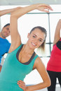 People doing power fitness exercise at yoga class portrait of smiling Stock Photography