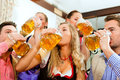 People drinking beer in Bavarian pub Royalty Free Stock Photo