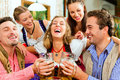 People drinking beer in Bavarian pub Stock Photography