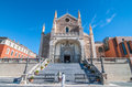 People emerge from an old cathedral church in Madrid, Spain on a beautiful sunny day. Royalty Free Stock Photo