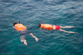 People engaged in snorkeling andaman sea coast thailand life jackets phi phi islands Stock Photos