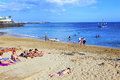 People enjoy the artifical beach playa blanca spain april playa dorada on april in playa blanca spain was restored in Stock Photos