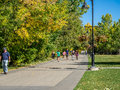 People enjoying calgary s pathway system on september in alberta pathways extend for hundreds of kilometers and Stock Photos
