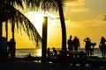 People Enjoying a Caribbean Sunset, Split, Caye Caulker, Belize Royalty Free Stock Photo