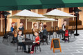 People enjoying coffee outside of a cafe vector illustration Stock Images