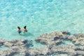People enjoying the crystal clear waters at Hanauma Bay