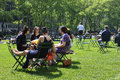 People enjoying a nice day in bryant park new york usa may on may new york city ny is acre privately managed Royalty Free Stock Images