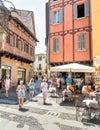 People enjoying a street bar in historic center of Como, Italy