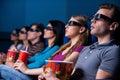 People enjoying three-dimensional movie. Royalty Free Stock Photo