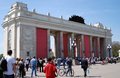 People enter the main entrance of gorky park in moscow arch is decorated by red flags it s a traditional place war Royalty Free Stock Photo