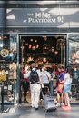 People entering Harry Potter shop by 9 3/4 platform inside King`s Cross Station, London, UK.