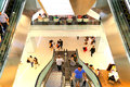 People on escalators in a shopping mall view downwards at harbor city hong kong Royalty Free Stock Images