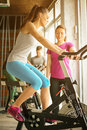 People exercising on stationary bikes in fitness class. Royalty Free Stock Photo