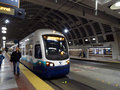 People exit Sound Transit light rail train Royalty Free Stock Photo