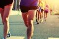 People feet on city road in marathon running race