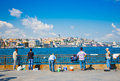 People fish near the galata bridge istanbul on august turkey in turkey is only metropolis in Royalty Free Stock Images