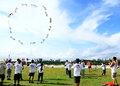 People flying kites are group at marina barrage in singapore Stock Images