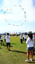 People flying kites are group at marina barrage in singapore Royalty Free Stock Photography
