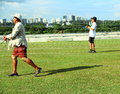 People flying kites are group at marina barrage in singapore one man is running through threads Royalty Free Stock Image