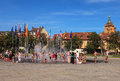 People at the fountain on Place Rapp square in Colmar, France