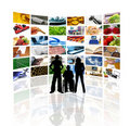 People in front of wall of tv screens Stock Image
