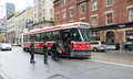 People getting on a toronto streetcar this old bombardier streetcars will be replaced in lapse of five years by the new Royalty Free Stock Photo