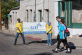 People with GLBT Chamber of Commerce Sign at AIDSwalk Royalty Free Stock Photo