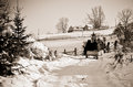 People go sledding to home on snow road at the mountain in winter Royalty Free Stock Photo