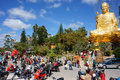People go to pagoda da lat vietnam jan pray lucky yellow statue of buddha in blue sky crowd of buddhist visit with belief faith Royalty Free Stock Photos