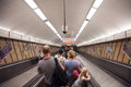 People going down a metro station of Budapest on an escalator Royalty Free Stock Photo