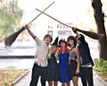 People group with broom, Halloween witch costume Royalty Free Stock Photography