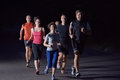 People Group Jogging At Night