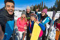 People Group With Snowboard Ski Resort Snow Winter Mountain Cheerful Friends Sitting On Wooden Hence Talking