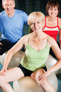 People in gym on exercise ball Royalty Free Stock Image