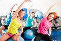 People in gym on exercise ball Stock Image
