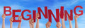 People hands holding red word beginning blue sky many caucasian and letters or characters building the english on Stock Photos