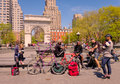 People hanging out new york city men and a woman sit read talk socialize and hang near the arch in washington square park near Royalty Free Stock Photo
