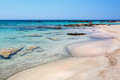 People having a rest on the beach of Elafonissi. Crete. Greece. Royalty Free Stock Photo