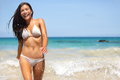 People having summer beach fun woman in water smiling happy walking towards camera bikini girl on travel vacation on hapuna Stock Photos