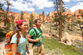 People hiking couple hikers in bryce canyon walking smiling happy together multiracial young asian women and caucasian men Royalty Free Stock Photography
