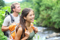 People hiking happy hiker couple on hawaii trekking as part of healthy lifestyle outdoors activity young multiracial walking in Stock Photos