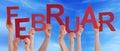 People Hold German Februar Means February Blue Sky
