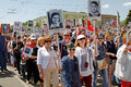 People hold portraits of their relatives in the action `Immortal regiment` on Victory day in Volgograd Royalty Free Stock Photo