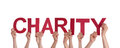 People holding charity many in red isolated Royalty Free Stock Image