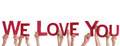 People holding we love you many the red words isolated Stock Photography
