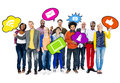 People holding speech bubbles with symbols group of friends containing images social networking theme Royalty Free Stock Photography
