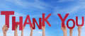 People holding thank you in the sky many word Royalty Free Stock Photos