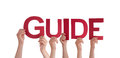 People Holding the Word Guide Royalty Free Stock Photo